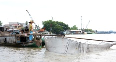 Checking their nets for holes on the Mekong Delta