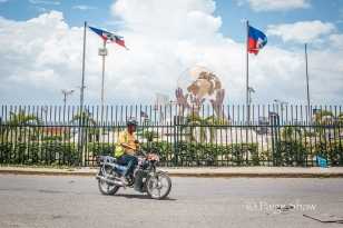 three-hand-statue-motorcyclist-port-au-prince-haiti