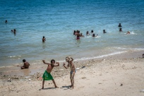 kids-hanging-out-seaside-swimming-port-moresby-papua-new-guinea