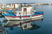 boat-reflection-larnaca-marina-cyprus