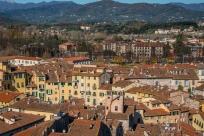 rooftops-mountains-torre-guinigi-lucca-italy